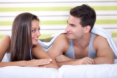 Cute couple in bed Royalty Free Stock Photos