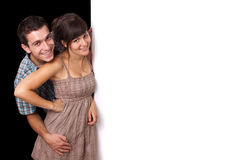 A cute couple behind a white wall 2 Royalty Free Stock Photo