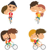 Cute couple on bikes Stock Images