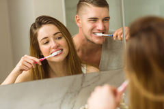 Cute couple brushing their teeth Royalty Free Stock Image