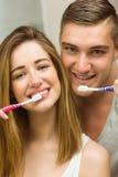Cute couple brushing their teeth Stock Photo