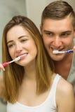 Cute couple brushing their teeth Stock Photos