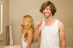 Cute couple brushing their teeth together Royalty Free Stock Photos