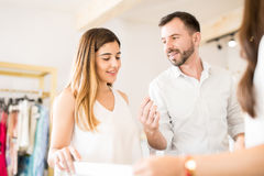 Cute couple buying a diamond ring Stock Images
