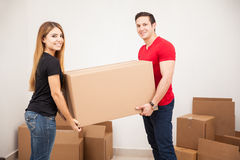 Cute couple carrying a big box Stock Photography