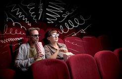 Cute couple in cinema watching movie royalty free stock photography