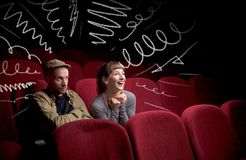Cute couple in cinema watching movie stock image