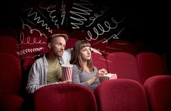 Cute couple in cinema watching movie royalty free stock image