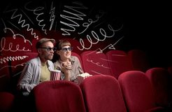 Cute couple in cinema watching movie royalty free stock images