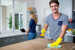 Cute couple cleaning up Royalty Free Stock Image
