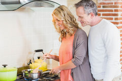 Cute couple cooking Stock Image