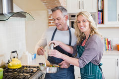 Cute couple cooking Stock Photography