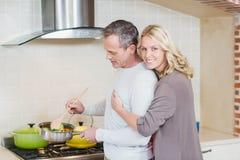 Cute couple cooking Stock Photos