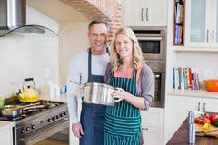 Cute couple cooking Stock Images