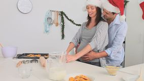Cute couple cooking together Stock Image