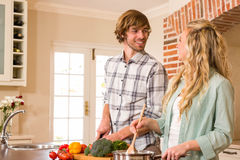 Cute couple cooking together Stock Photos