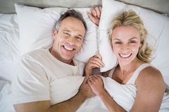 Cute couple cuddling in bed Royalty Free Stock Photography