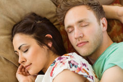 Cute couple cuddling on couch Royalty Free Stock Photography