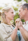Cute couple dancing and holding hands Stock Photos