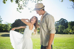 Cute couple dancing in the park and laughing Stock Photo