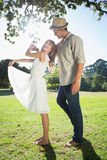 Cute couple dancing in the park and laughing Stock Photography