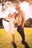 Cute couple dancing in the park and laughing Royalty Free Stock Photo