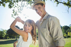 Cute couple dancing in the park smiling at camera Royalty Free Stock Images