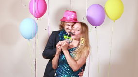 Cute couple dancing in photo booth. Cute smiling couple dancing in photo booth stock video
