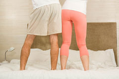 Cute couple dancing on their bed Royalty Free Stock Photos