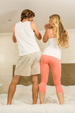 Cute couple dancing on their bed Royalty Free Stock Photography