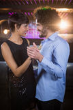 Cute couple dancing together on dance floor Stock Photography