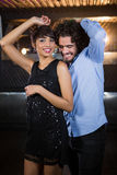Cute couple dancing together on dance floor Royalty Free Stock Photography
