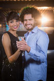 Cute couple dancing together on dance floor Stock Image