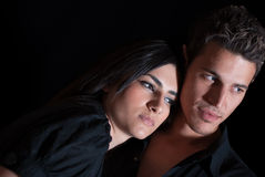 Cute couple in dark studio, nice portrait Royalty Free Stock Photography