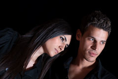 Cute couple in dark studio, nice portrait Royalty Free Stock Images