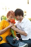 Cute couple on date. With flowers Royalty Free Stock Photos