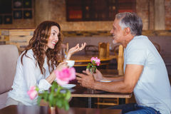 Cute couple on a date. At the cafe Stock Images