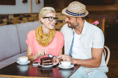 Cute couple on a date eating a piece of chocolate cake Stock Images