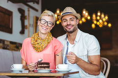 Cute couple on a date eating a piece of chocolate cake Royalty Free Stock Image