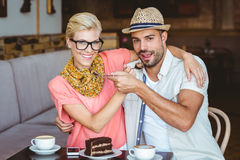 Cute couple on a date giving each other food Royalty Free Stock Photography