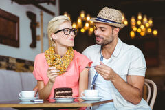 Cute couple on a date giving each other food. At the cafe Royalty Free Stock Photography