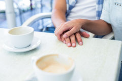 Cute couple on a date holding hands Royalty Free Stock Photos