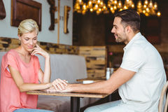 Cute couple on a date holding hands Stock Photo