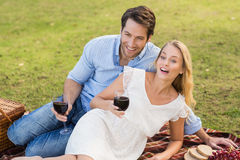 Cute couple on date holding red wine glasses Royalty Free Stock Photo