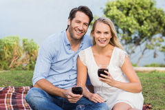 Cute couple on date holding red wine glasses Royalty Free Stock Photography