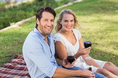 Cute couple on date holding red wine glasses Stock Photos