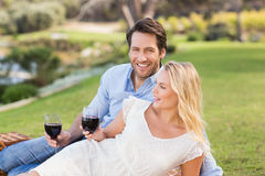 Cute couple on date holding red wine glasses Stock Image