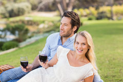 Cute couple on date holding red wine glasses Stock Images