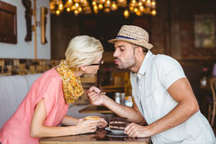 Cute couple on a date kissing each other Royalty Free Stock Photos