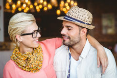 Cute couple on a date looking each other Stock Photography